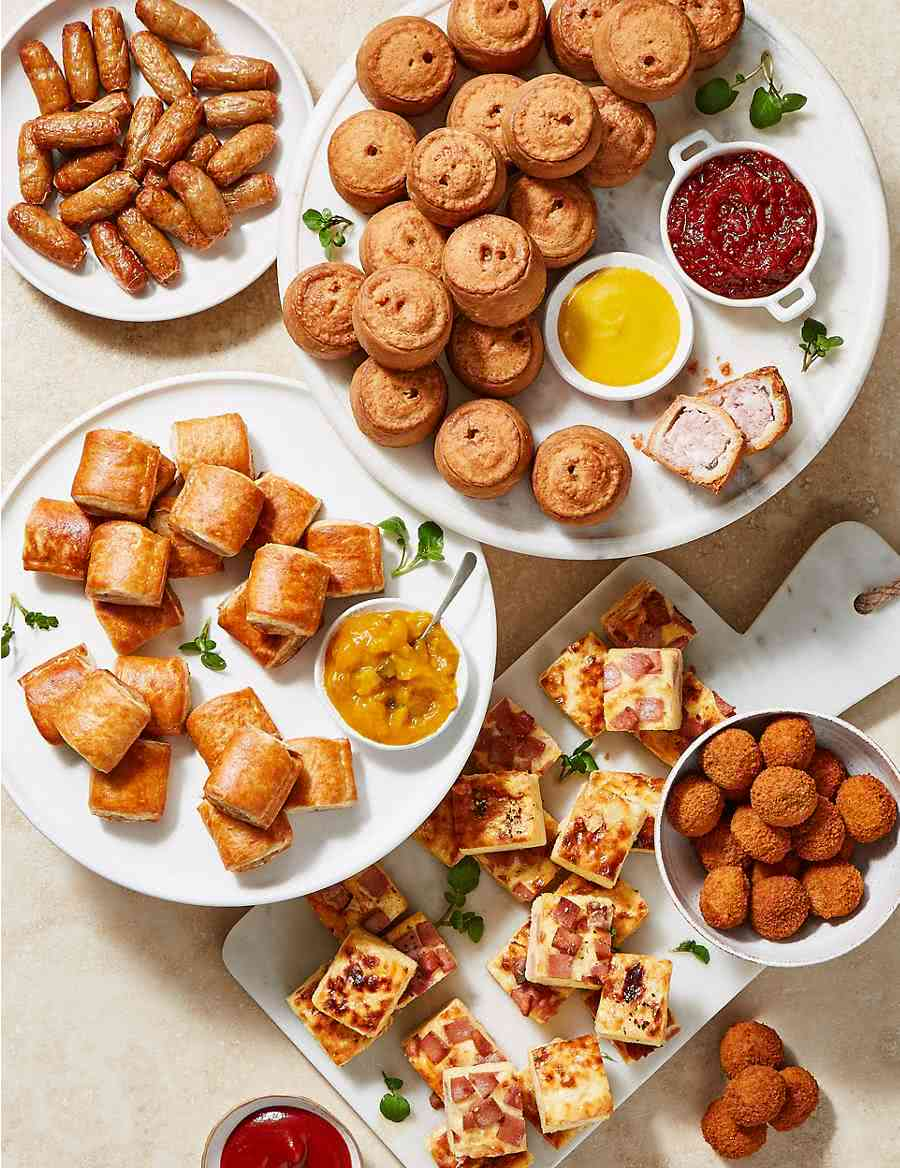 Plates of pork pies, sausage rolls and other finger food - Bachelorette Party Food for the Budget Bride