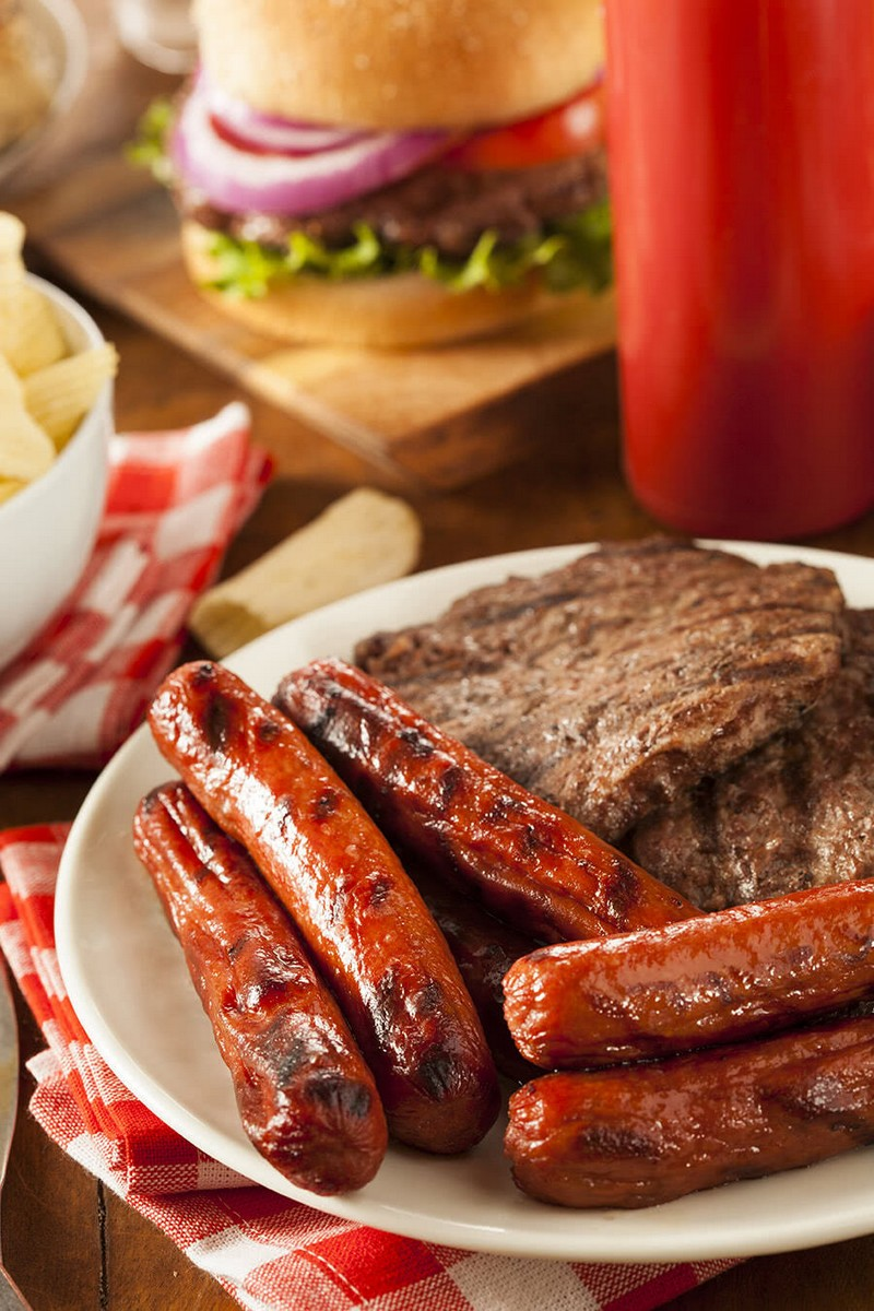Sausages and burgers on a plate - Bachelorette Party Food for the Casual Bride