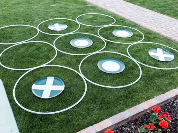 Paper plates and hula hoops on grass like noughts and crosses  - Bachelorette Party Activities for the Casual Bride