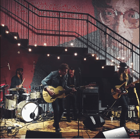 Band playing live in an a loft type space - Bachelorette Party Activities for the Break the Bank Bride