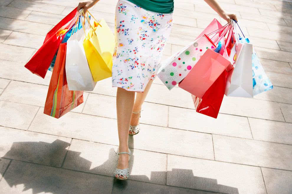 Woman carrying lots of shopping bags - Bachelorette Party Activities for the Break the Bank Bride