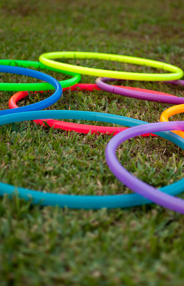 Hula hoops lying on grass - Bachelorette Party Decor for the Active Bride