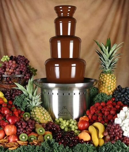 Chocolate fountain surrounded by fruit - Bachelorette Party Food and Drink for the Break the Bank Bride