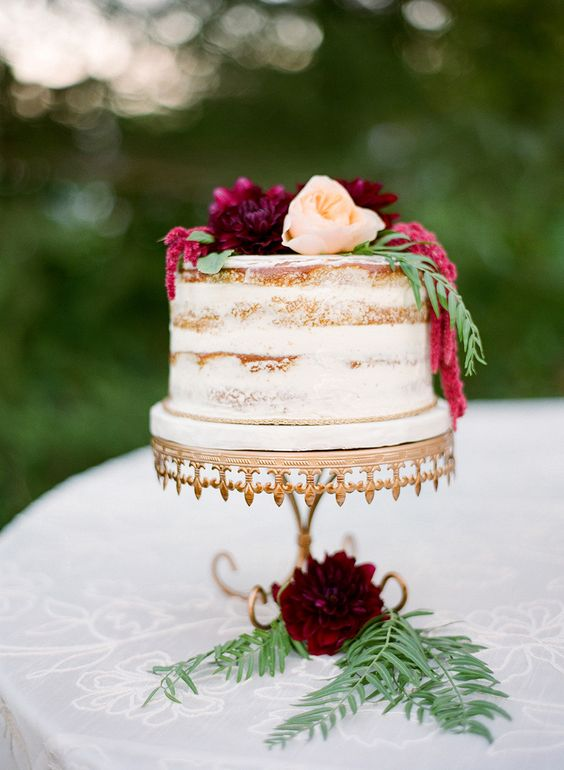 A flower sits in a piece of cake on a table  Description automatically generated