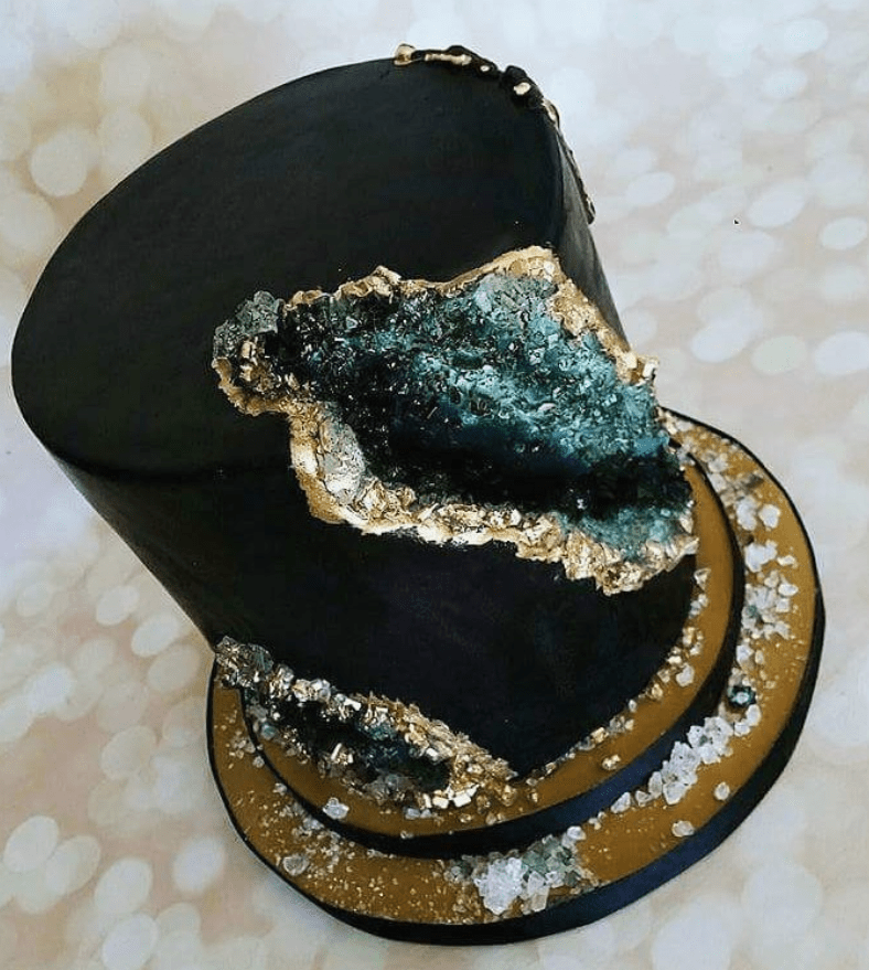 Black cake with gold and green geode cut outs - Ideas for a Loki Themed Hen Party Food