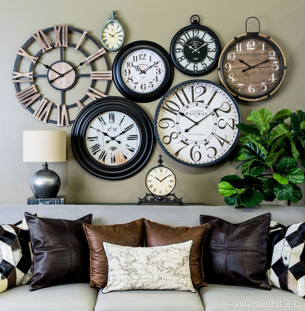 A wall filled with different styles of clocks - Ideas for a Loki Themed Hen weekend Decor
